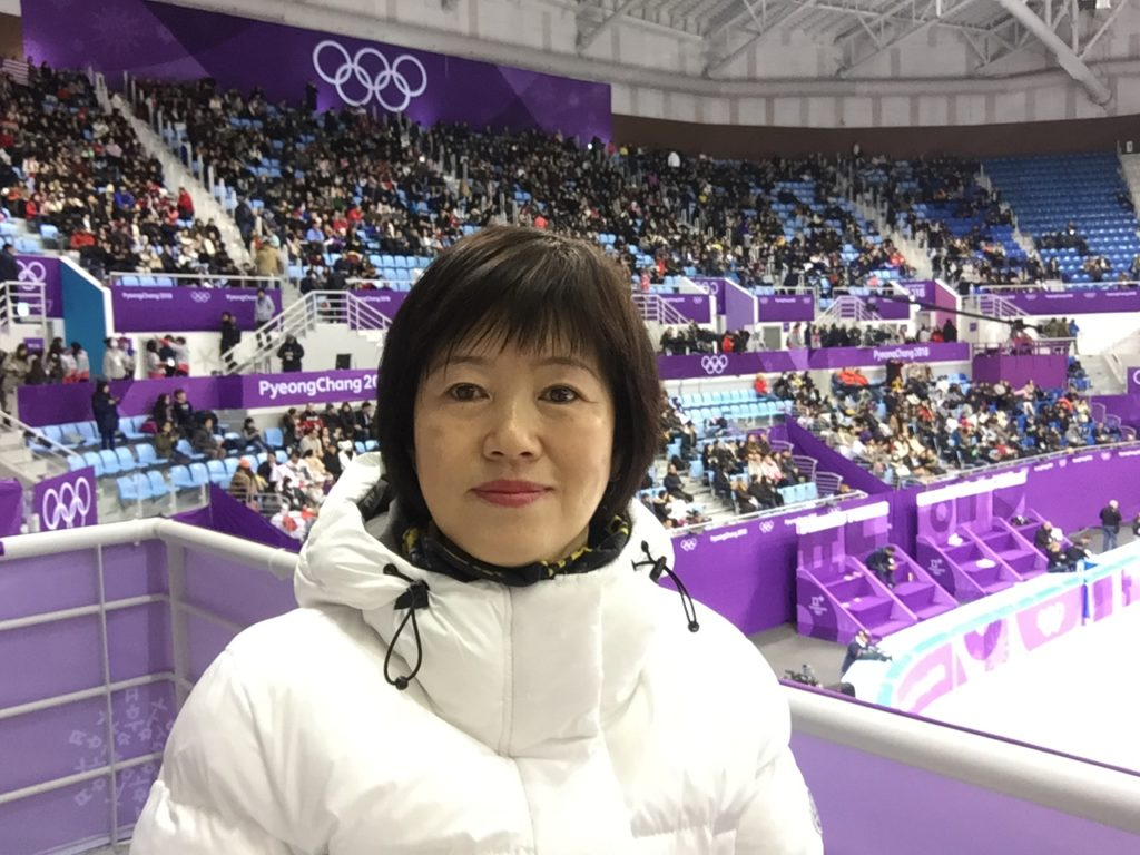 Heejeong in the crowd of the winter olympics stadium