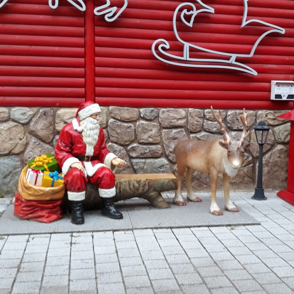Santa Clause and Reindeer statue