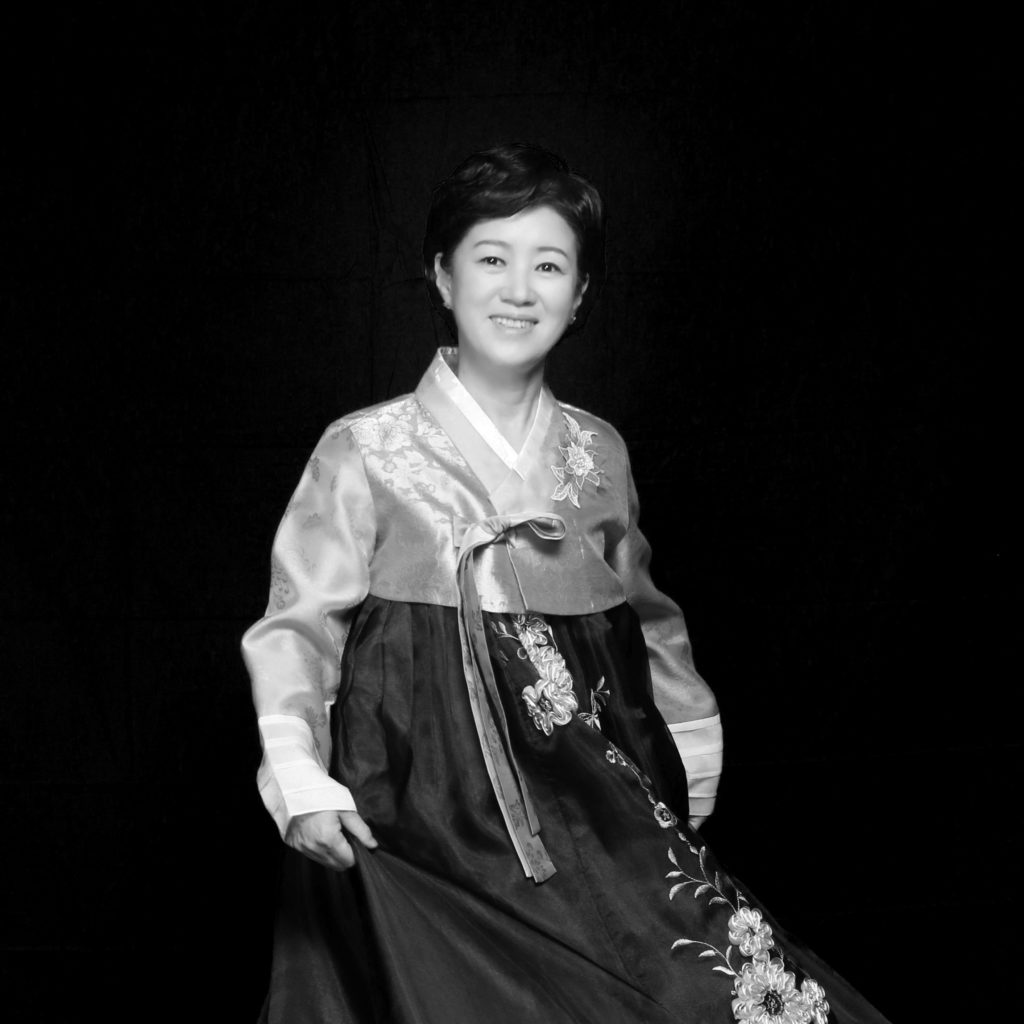 Black and white portrait of Heejeong wearing a traditional Korean dress