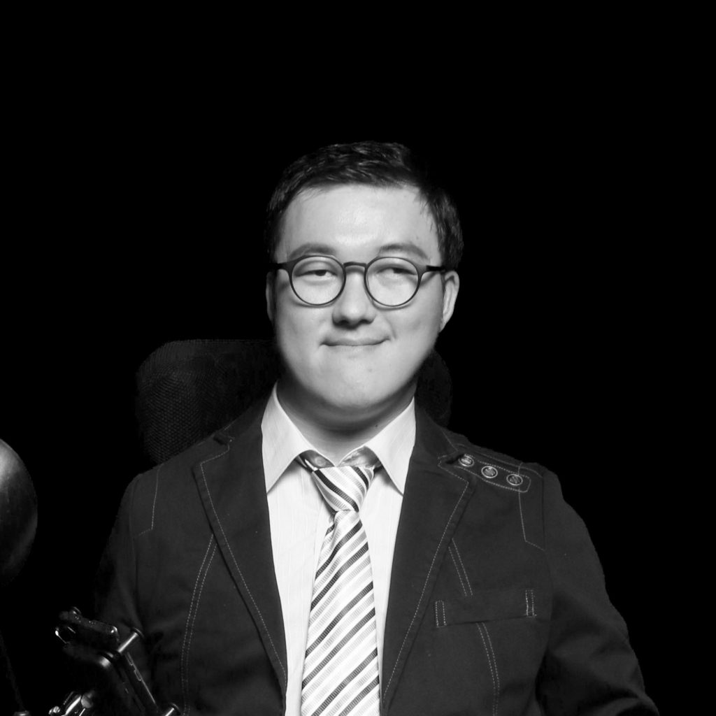 Black and white portrait of Sangjun in a jacket and tie